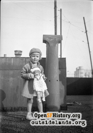Girl with doll on roof,1920s
