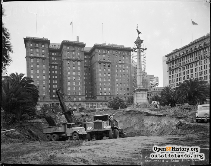 Union Square Garage Construction, ground level view east from Stockton Street. St. Francis Hotel in background.