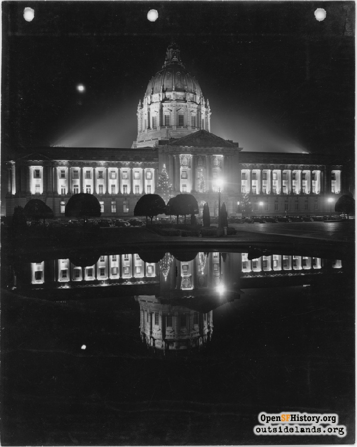 City Hall decorated for Christmas with reflection in pool, circa 1936.