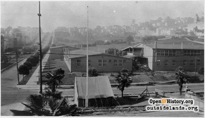 Temporary buildings in Mission Park and tent on Mission High grounds used for classes after fire, circa 1922.