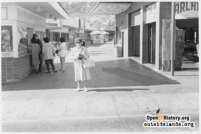 Older woman posing on midway near Cabrillo Street. View north in 1962.