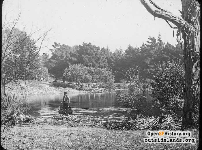 Man on a small boat on South Lake in Golden Gate Park, 1910s.