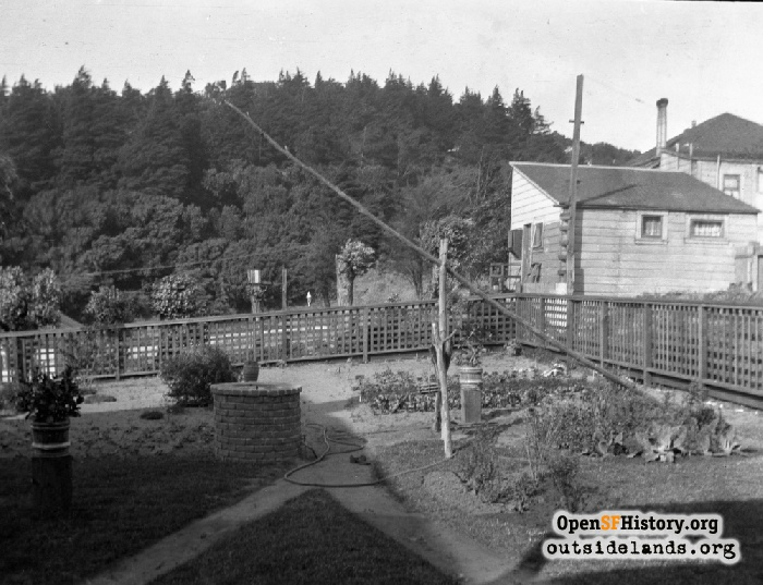 Backyard of 1526 Masonic Avenue with well and Buena Vista Park beyond, c.1912.