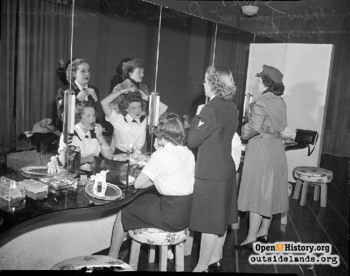WAVES Mildred Campbell, Eleanor Jones and Inez Hanson, and Margaret Kilroy of the Marine Corps, at the Pepsi-Cola Center, December 31, 1943.