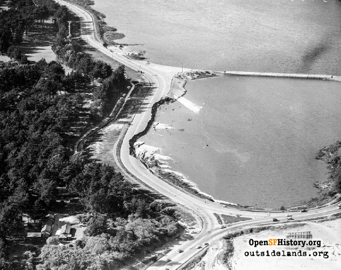 Aerial over Lake Merced looking north at collapsed section of John Muir Drive, March 22, 1957.