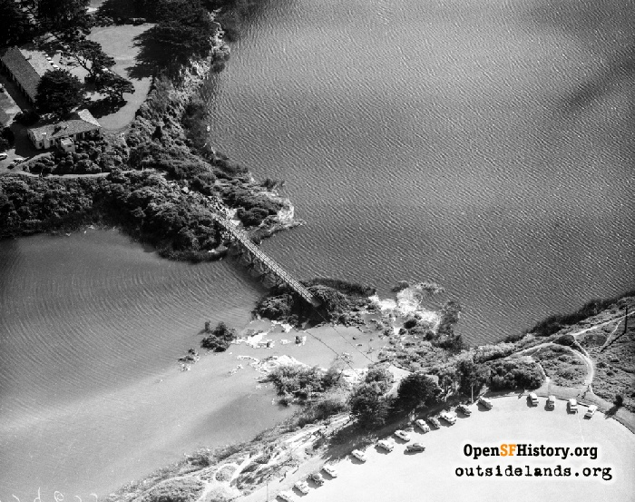Aerial over Lake Merced to damage of Lake Merced Bridge south of Sunset Circle parking lot, March 22, 1957.