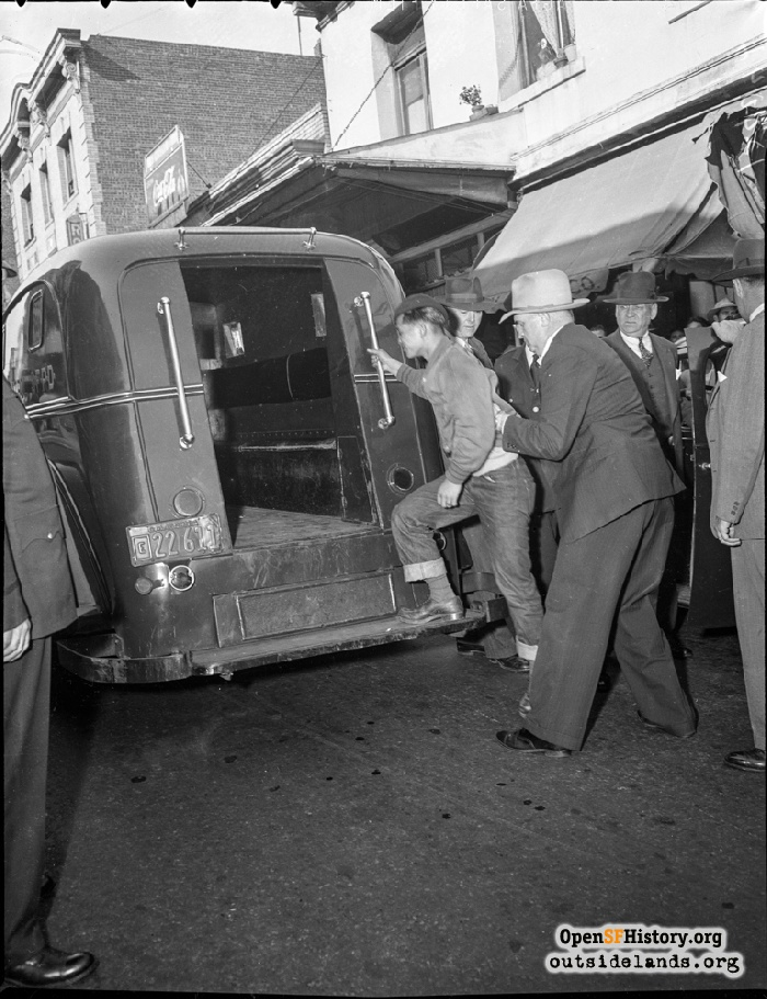 Teen being guided into paddy wagon on Grant Street near Pacific, September 30, 1943.