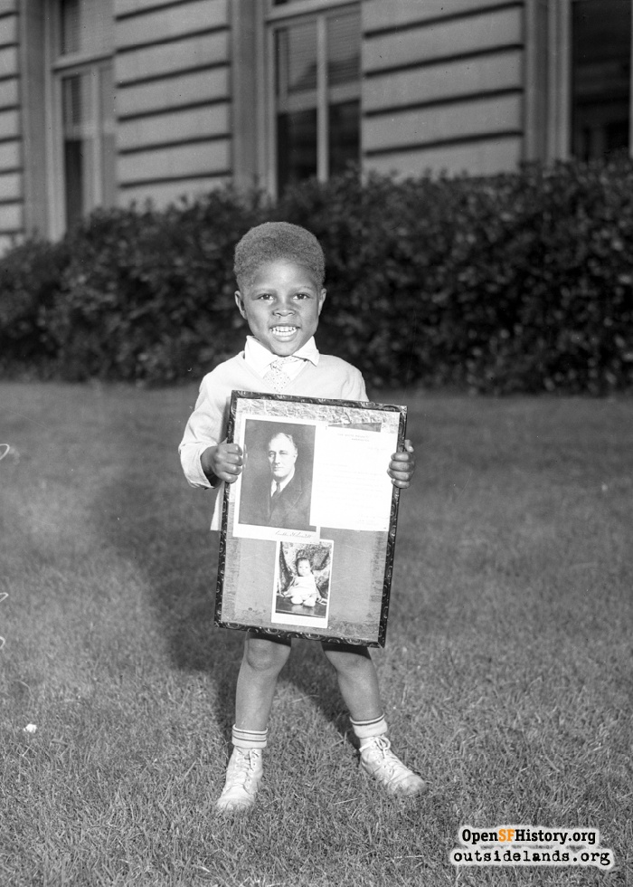 Boy with FDR poster, probably in front of City Hall.