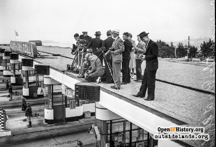 Press photographers on roof of Golden Gate Bridge toll plaza waiting for arrival of President Roosevelt motorcade from Marin County, July 14, 1938.