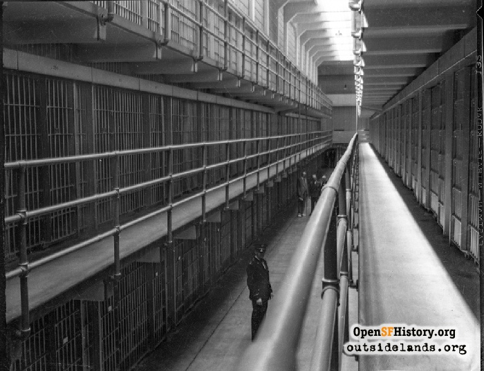 Cellblock interior of Alcatraz during inspection tour by Mayor Angelo Rossi, Warden James A. Johnston, and U.S. Attorney General Homer Cummings. August 22, 1934.