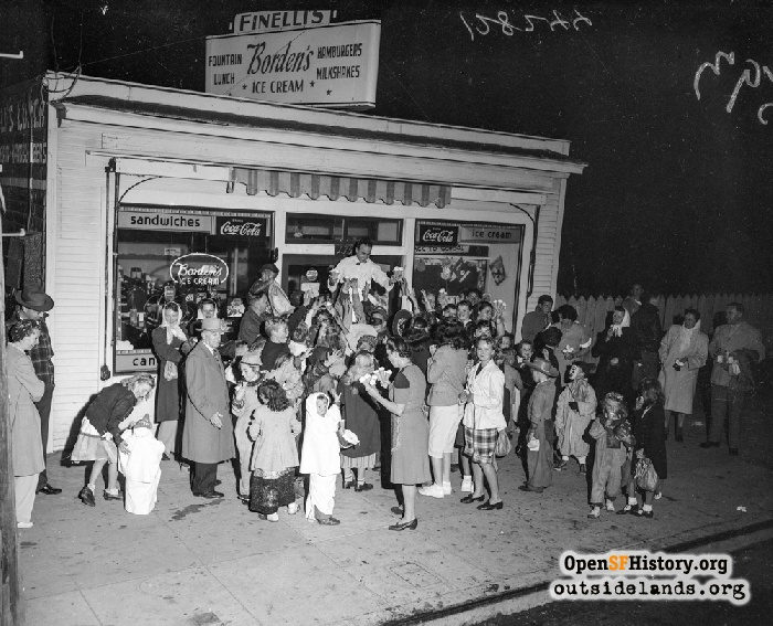 Peter Finelli gives away ice cream at 1356 42nd Avenue, directly across from Francis Scott Key school annex, on October 31, 1946.