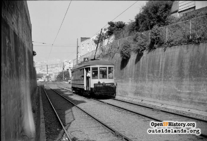 J-Church streetcar in private right-of-way approaching Liberty Street, 1962.