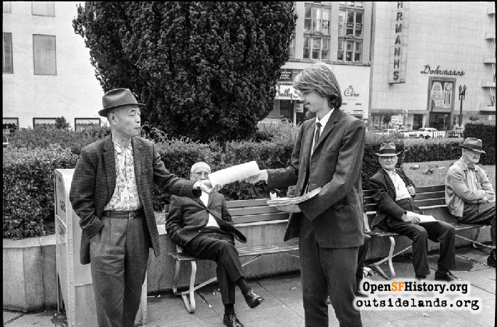 Chet Helms passing out flyers at Union Square marijuana rally, September 6, 1964.