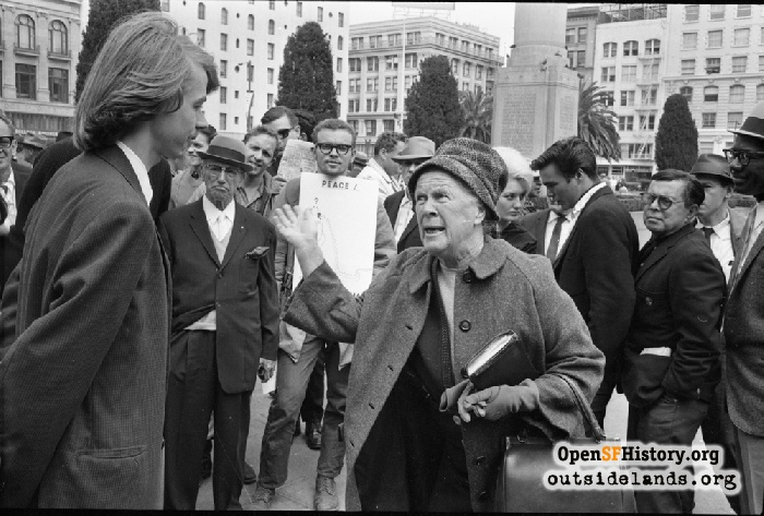 Naomi Annette lecturing Chet Helms at Union Square marijuana rally, September 6, 1964.