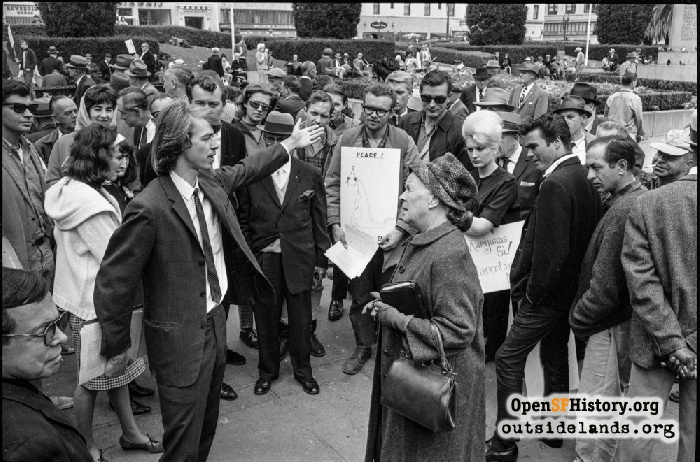 Chet Helms debating with Naomi Annette at Union Square marijuana rally, September 6, 1964.
