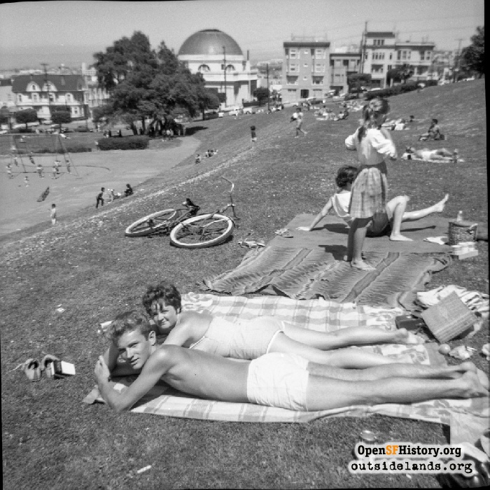 Couple sunbathing in Dolores Park, 1964.