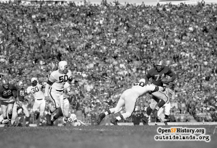 49er running back Joe Perry carrying the ball against the Cleveland Browns, November 28, 1948.