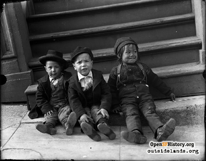 Three kids posed somewhere in San Francisco, circa 1900.