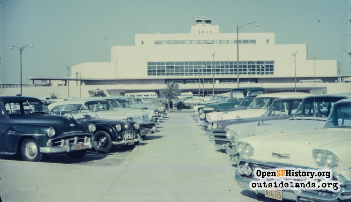 San Francisco Airport parking lot with terminal in distance, circa 1959.