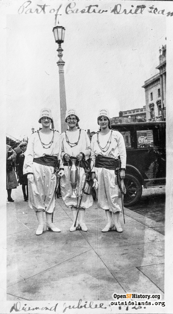 Native Daughters of the Golden West Castro Drill team, in costume, with swords, holding a loving cup at California's Diamond Jubilee at Grove and Larkin Streets, September 1925.