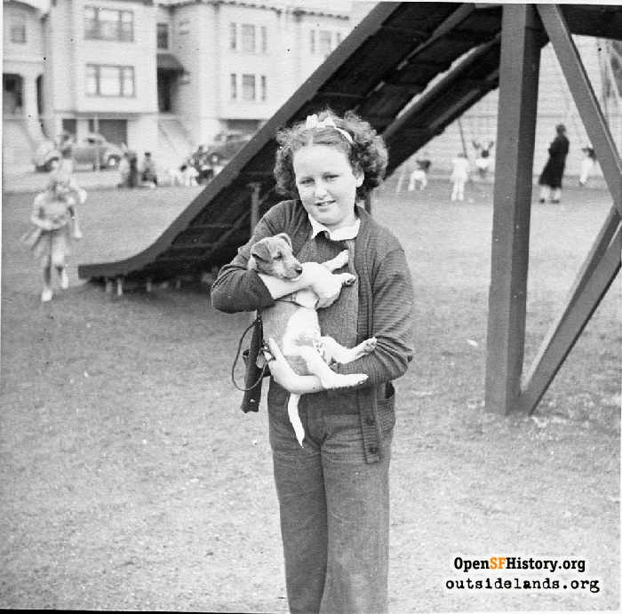 Girl and her dog in front of slides at Argonne Playground, 1940s.