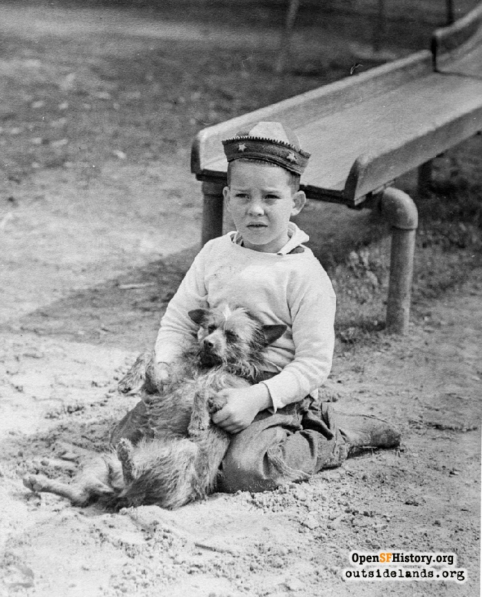 Boy and his dog by slide at Argonne Playground, 1940s.