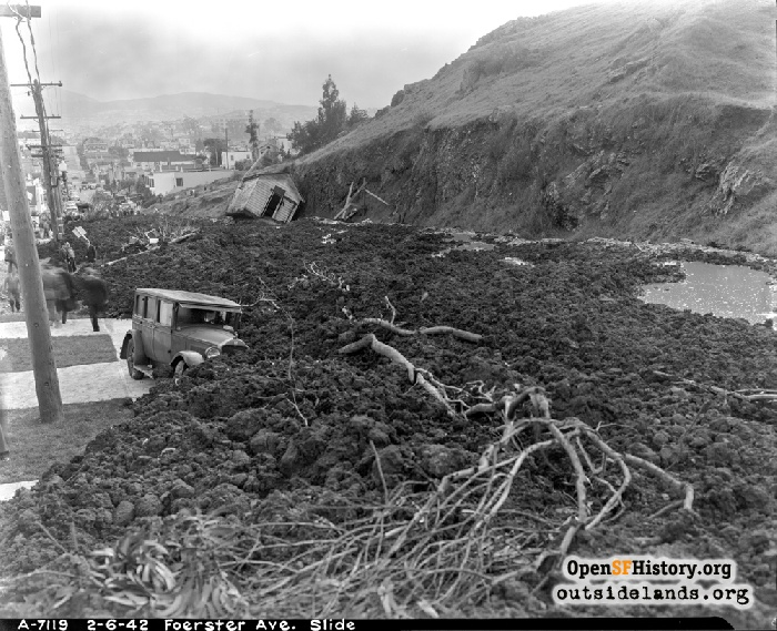 View south on Foerster Street beyond house knocked on its side after mudslide, February 6, 1942.
