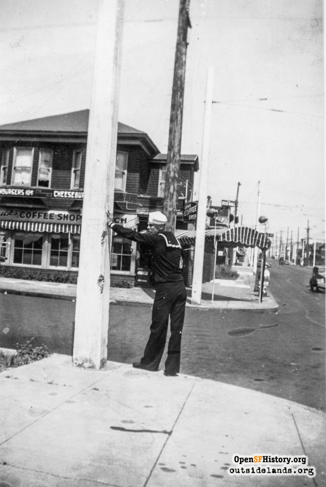 Sailor standing at corner of Judah and La Playa across from coffee shop, circa 1937.
