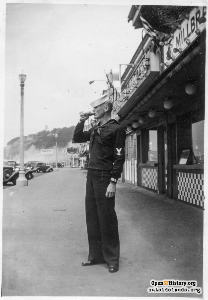 Sailor drinking at Playland, circa 1937.