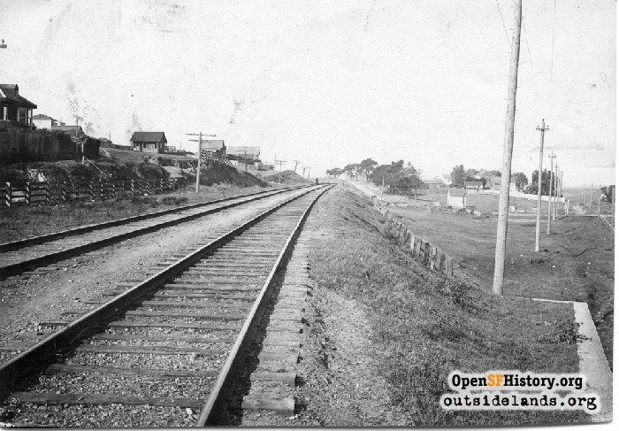 Looking west along the Southern Pacific Railroad tracks near the crossing of Ocean Shore Railroad's single track visible at right, October 4, 1918.