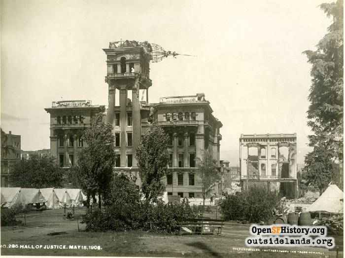 San Francisco Hall of Justice in ruins by Portsmouth Square refugee camp, 1906.
