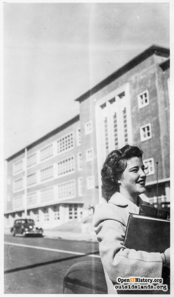 Female student with binder on 24th Avenue in front of Lincoln High School, 1943.