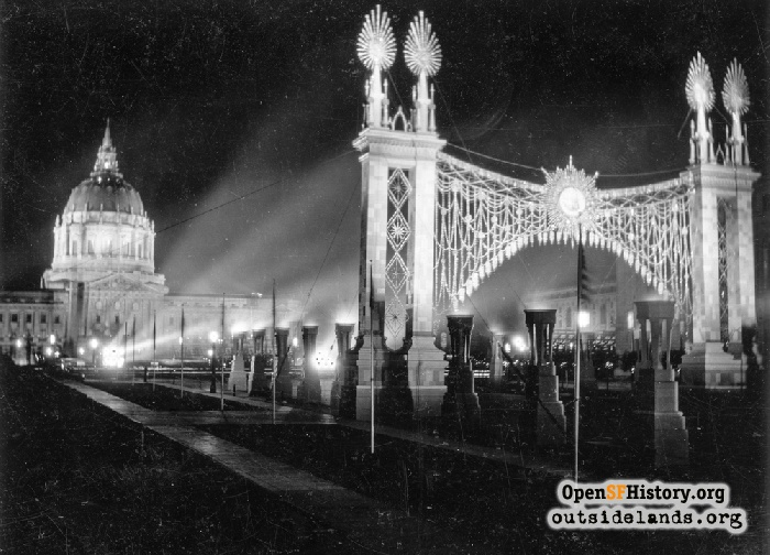 View of Arco de Brillantes, illuminated decorative archway, and City Hall, September 1925.
