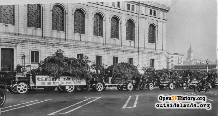 Second Examiner Christmas Tree on the way to Twin Peaks, passing the Main Library at Fulton Street near Larkin Street, December 30, 1928.