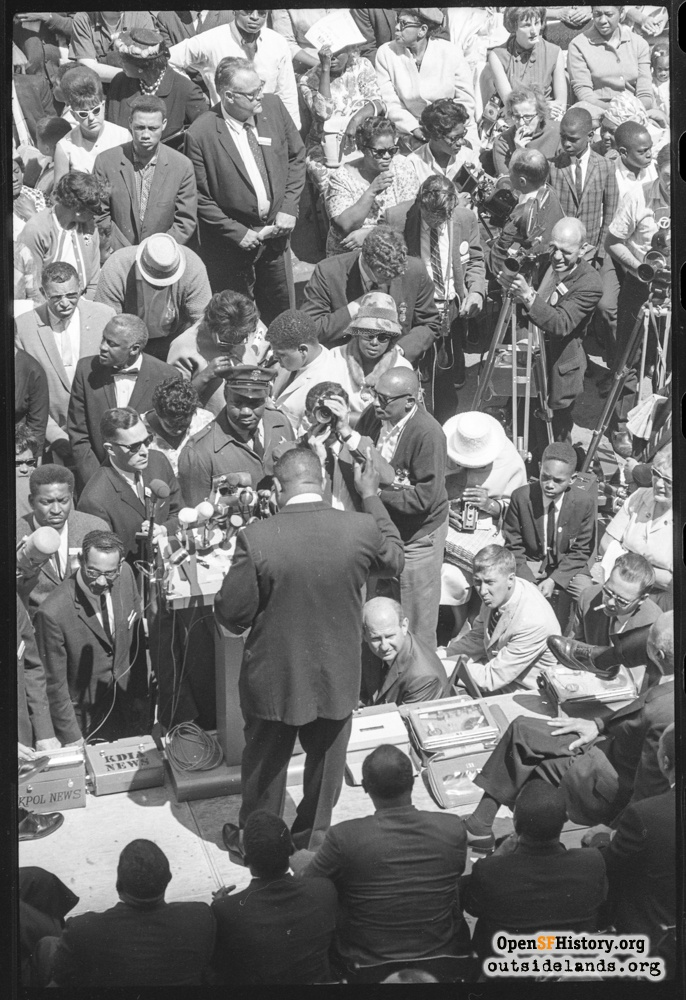 Speakers and reporters on Civic Center stage during Civil Rights march, July 12, 1964.