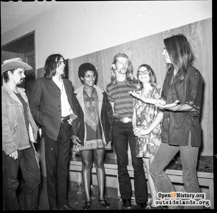 Grateful Dead and friends in the hallway of Hall of Justice, 850 Bryant, after sentencing for their marijuana bust. Ron 'Pigpen' McKernan, Rock Scully, Veronica Grant, Robert Matthews, Sue Swanson, Bob Weir on June 24, 1968.