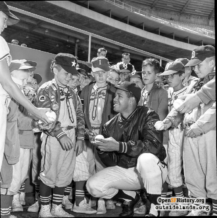 San Francisco Giants pitcher Juan Marichal and Little Leaguers at Candlestick Park, circa 1965.