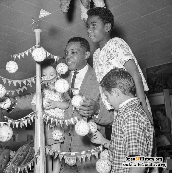 Willie Mays at Children's Hospital in Oakland for Christmas Tree benefit auction, November 1964.