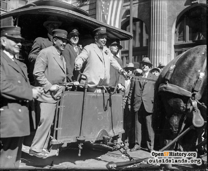Mayor Rolph driving last horse streetcar on Montgomery Street, October 5, 1927.