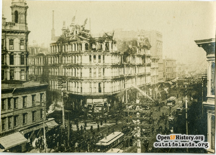 Fire-fighters hosing down the Baldwin Hotel at Powell and Market after the early morning fire on November 23, 1898.