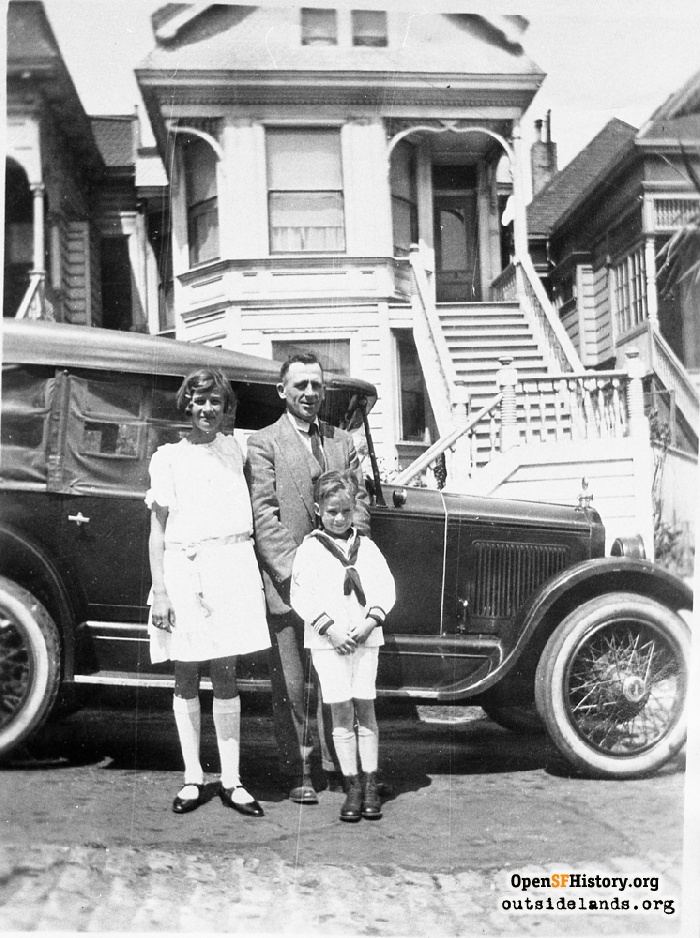 Father with daughter and son in front of 834 Elizabeth Street, circa 1920.