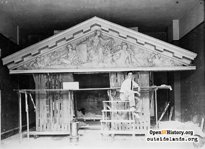 Sculpter Henri Crenier with his frieze for City Hall' entry pediment, March 31, 1914