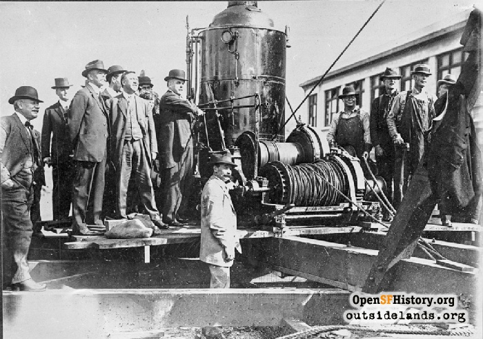Mayor James Rolph operating pile driver on Van Ness for Muni project, April 6, 1914.