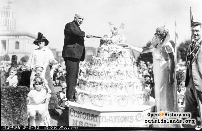 Governor James Rolph cutting Native of Sons of the Golden West cake for Admission Day.