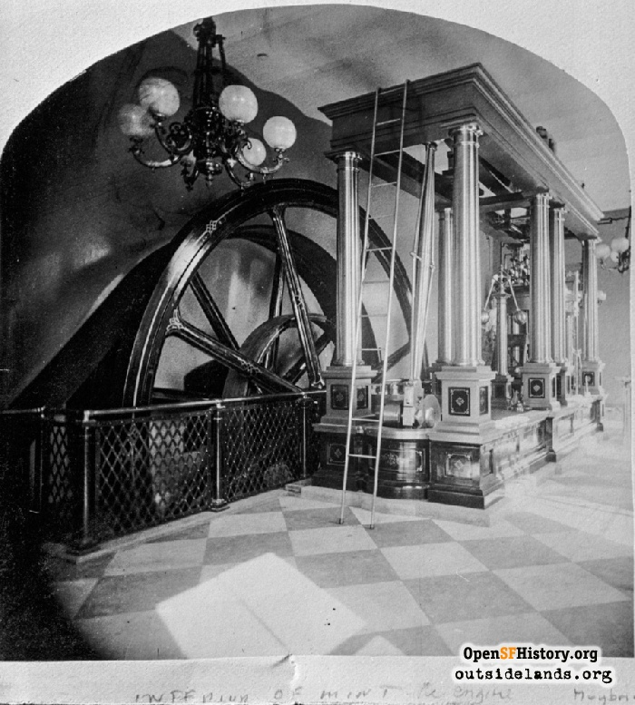 Massive pulley wheel, part of the engine works that powered the creation of millions of coins.