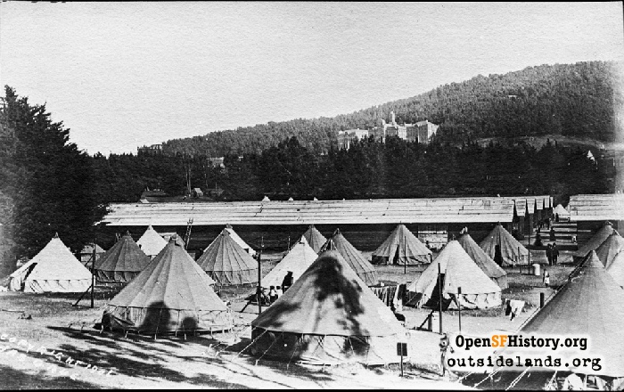 Earthquake refugee tents in Big Rec Field in Golden Gate Park with Affiliated College Buildings in background, 1906.