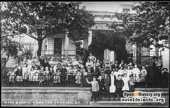 Children pose with staff on steps of Maud B. Booth Home for Children at 812 Shotwell Street, 1910s.