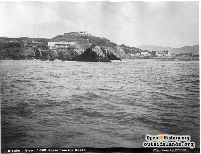 Cliff House, Cliff Cottage, and stables viewed from ocean, circa 1886.