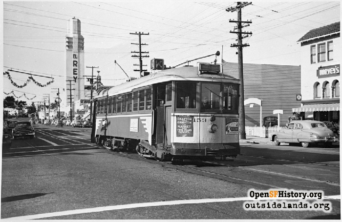 K-Line Streetcar on Ocean Avenue near Ashton Avenue with El Rey Theater in background, December 1951.