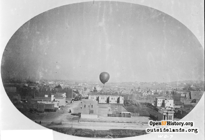 View east of a balloon ascension at Woodward's Gardens, taken from near Ramona Avenue and 14th Street, circa 1883.